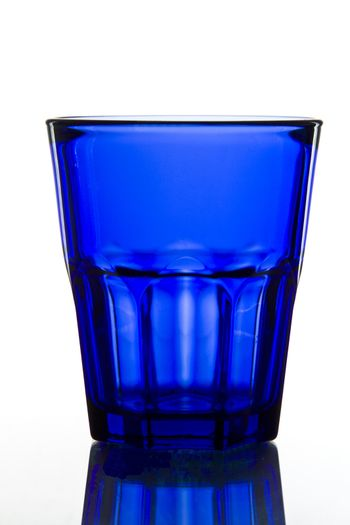 dark blue Glass on white background with reflection.