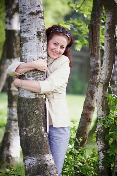 Woman embracing a birch