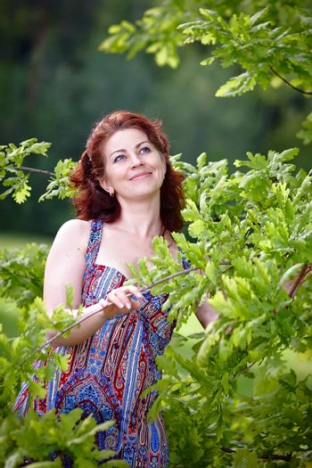 Woman with oak branches