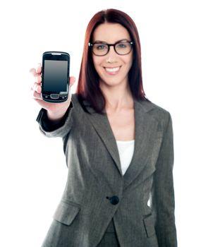 Saleswoman displaying latest mobile handset