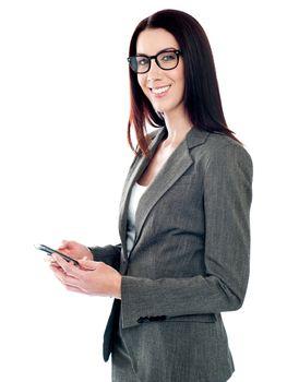Confident businessperson messaging