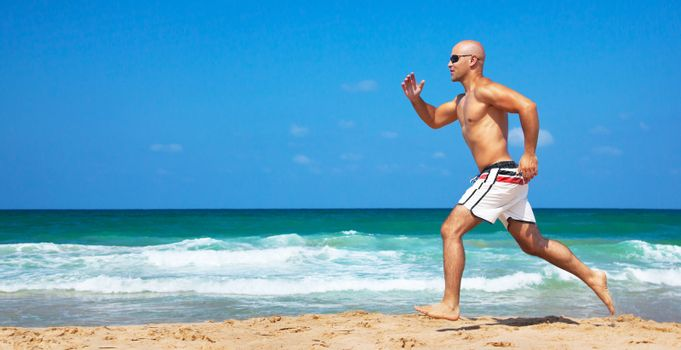 Healthy man running on the beach