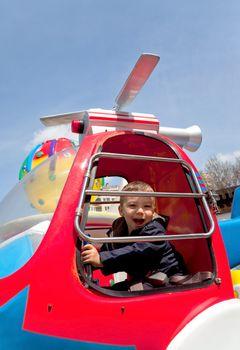 boy riding carousel