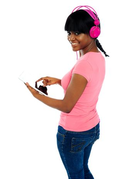 Girl listening to music via portable tablet