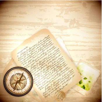 Vintage antique compass with old photo and letter  over wooden background