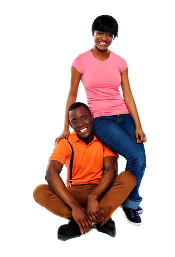 Woman in casuals sitting on mans shoulder