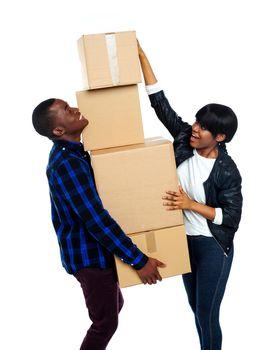 Teenage couple with cardboard boxes