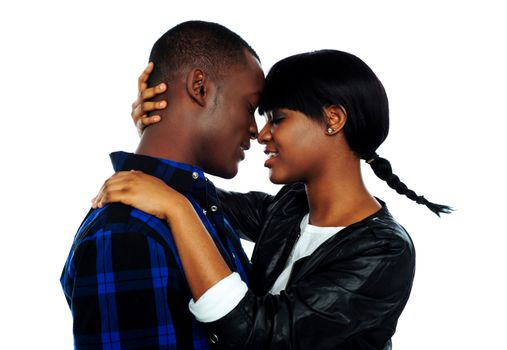 Young female about to kiss her boyfriend