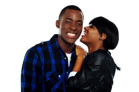 Girl sharing secrets with her boyfriend