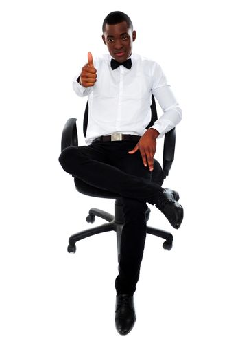 Confident man with thumbs-up gesture