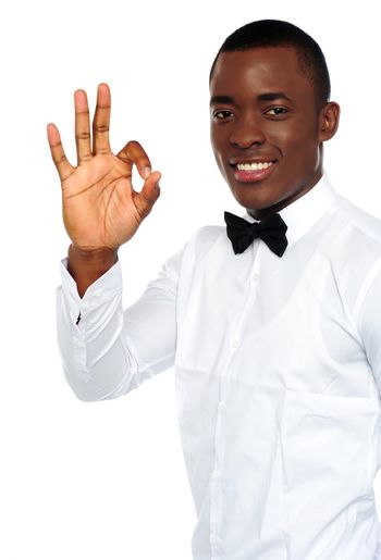 Young african boy showing okay gesture