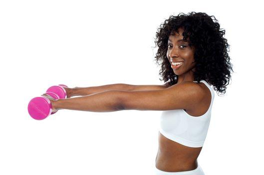 Fitness freak exercising with dumbbells