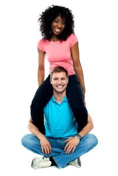 Girlfriend riding on her mans shoulder