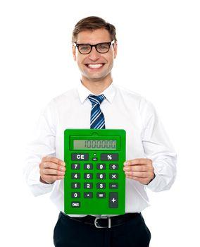 Male executive displaying green calculator