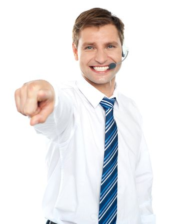 Male executive pointing at you