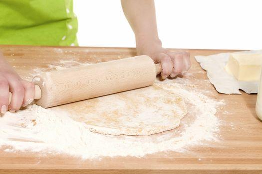 closeup of a rolling pin on dough