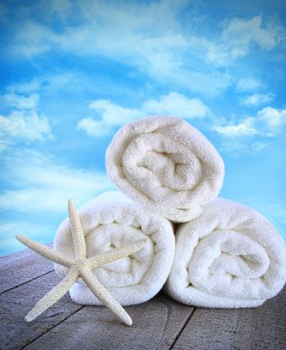 Fluffy fresh towels against a blue sky