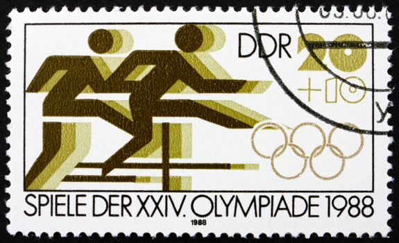 GDR - CIRCA 1988: a stamp printed in GDR shows Hurdle Race, 24th Summer Olympics, Seoul, South Korea, circa 1988