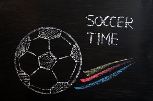 Chalk drawing of Football or soccer time on a wooden blackboard