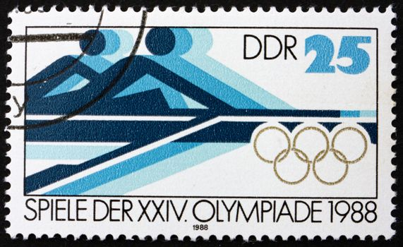 GDR - CIRCA 1988: a stamp printed in GDR shows Rowing, 24th Summer Olympics, Seoul, South Korea, circa 1988