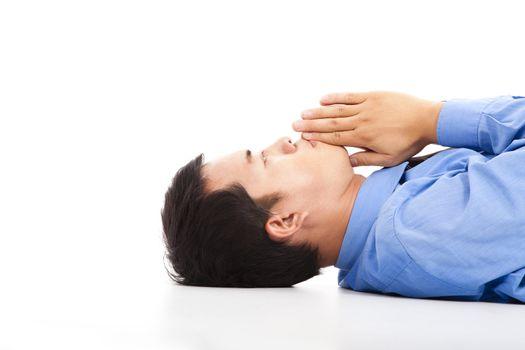 businessman lying on floor with praying