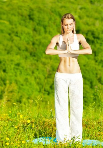 Healthy yoga woman exercising outdoor, fitness, sport and meditation lifestyle concept
