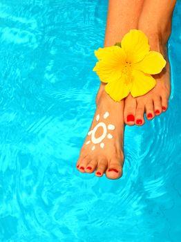 Beautiful female legs in the pool