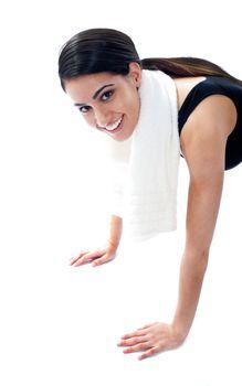 Female fitness trainer doing push ups