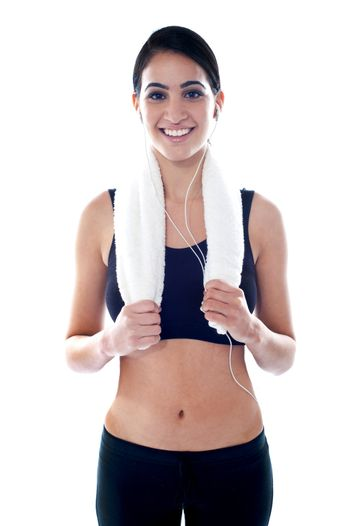 Fit woman listening to music