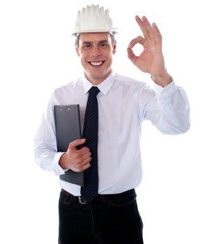 Handsome engineer showing okay gesture