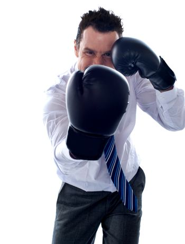 Corporate man posing boxing punch