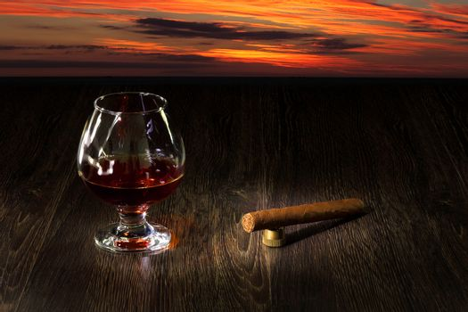 Glass of cognac and sigar