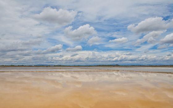 Reflection of sky on  salt farm