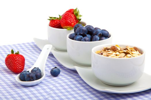 fresh berries in porcelain bowls, isolated on white background