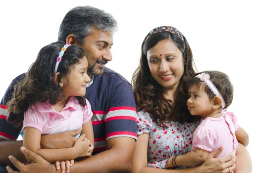 Modern Indian family with two daughter having conversation on white background