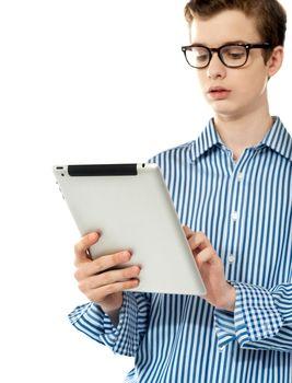 Stylish boy using touchpad device