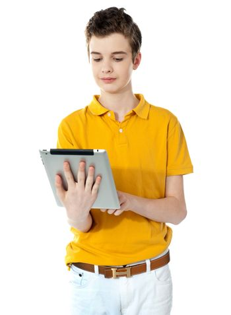 Portrait of a cute boy using a portable device