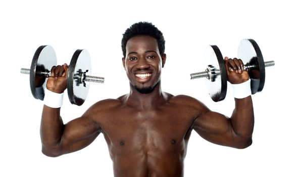 Male athlete holding dumbbells