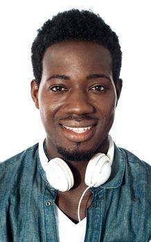 Guy with headphones around his neck