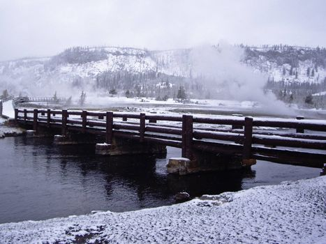 Snow storm over bridge in Yellowstone Park, USA