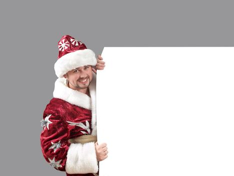 Santa Claus carrying a shield for advertisement
