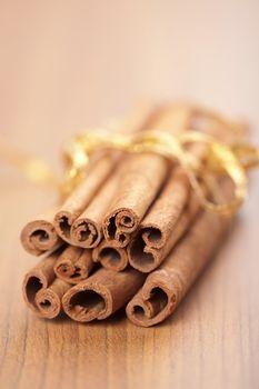 cinnamon with golden ribbon