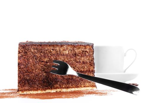chocolate cake with a fork and a cup of coffee