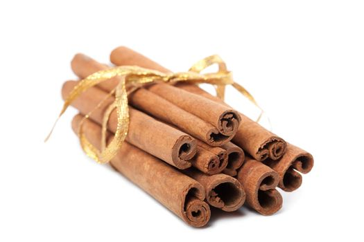 cinnamon with golden ribbon isolated