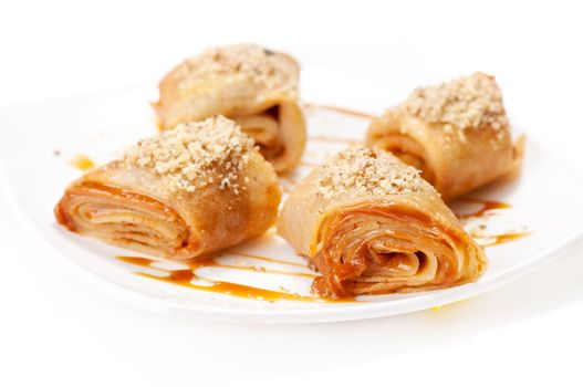 Rolled pancakes with caramel mousse