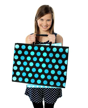 Teenager holding shopping bags