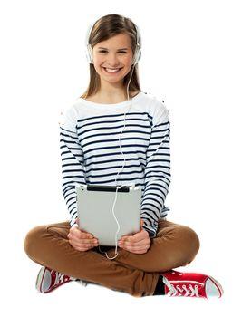 Teenager enjoying music through headphones