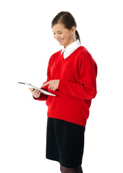 Beautiful teenage using electronic tablet