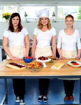 Female chefs decorating breakfast