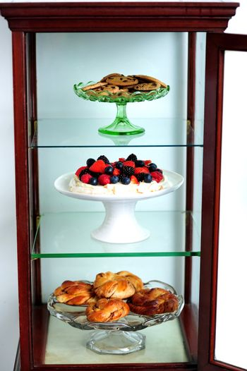 Shelf decorated by delicious desserts